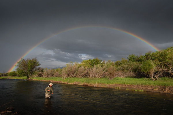 Rainbow over angler on the Madison River