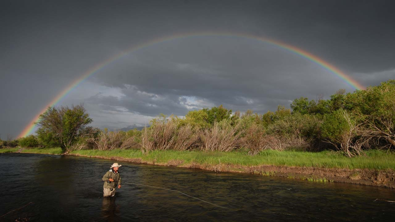 Rainbow over Angler on Madison River, Montana