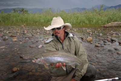 Cowboy Mike Elliott with a Rainbow Trout